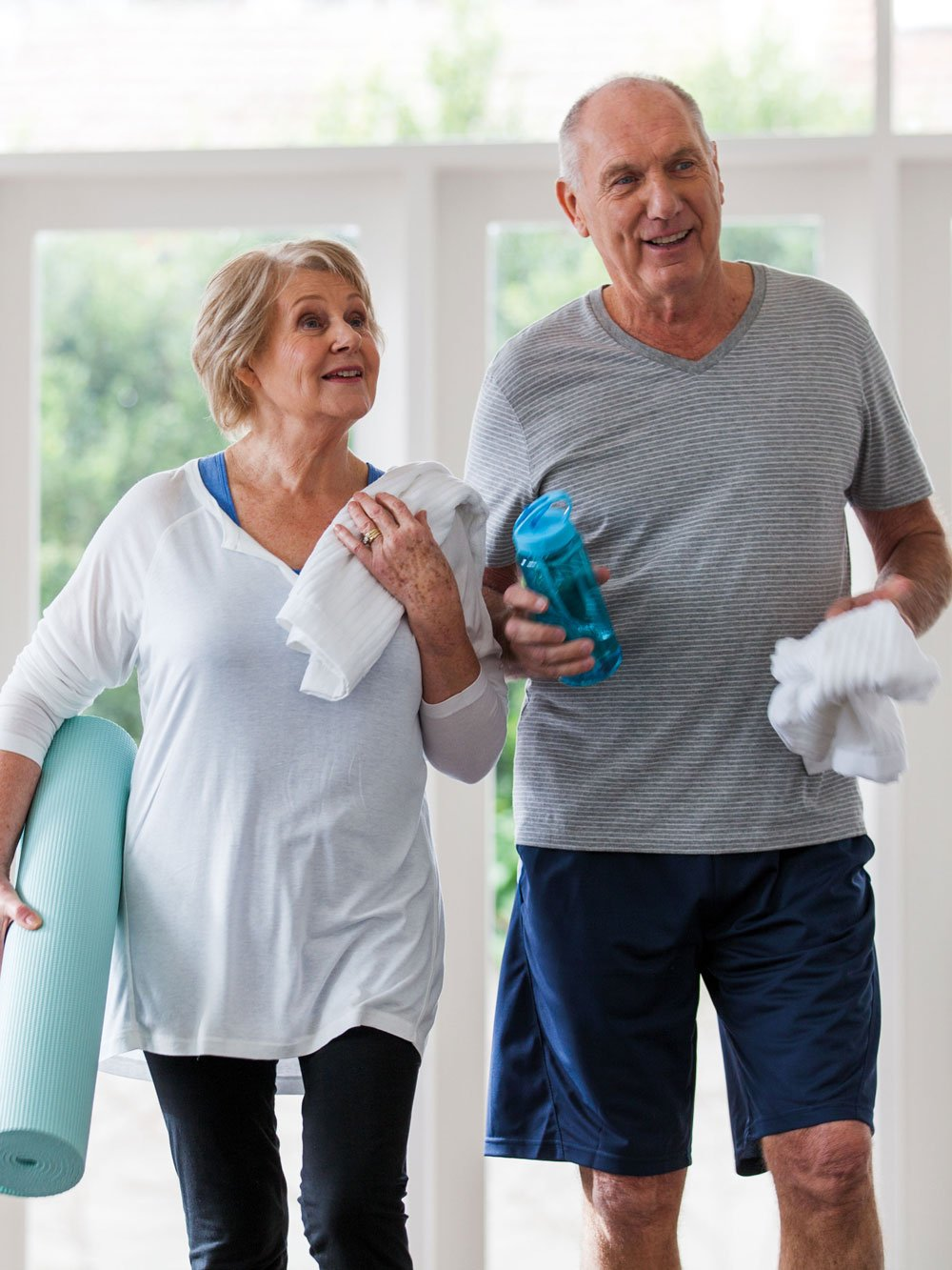 Senior couple in active wear walking to gym to exercise at Strathalan Macleod