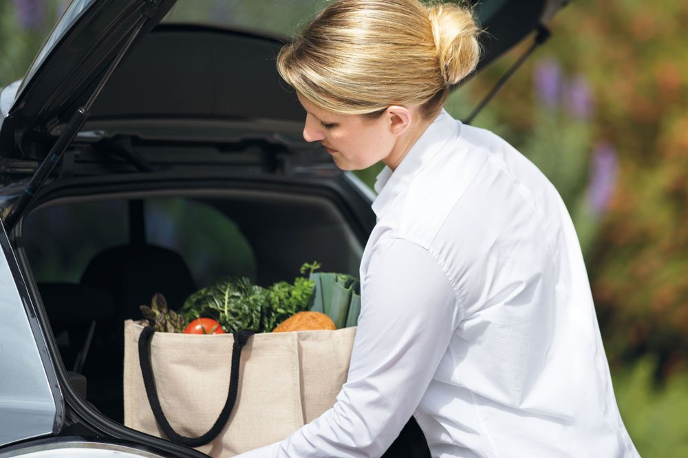Young woman getting groceries out of car boot at Strathalan Macleod